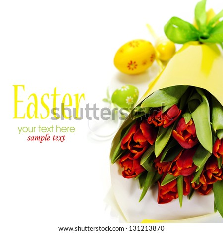 easter composition with fresh tulips and easter eggs over white (with easy removable text) - stock photo