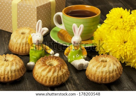Easter composition with gift box, muffins and  decorations