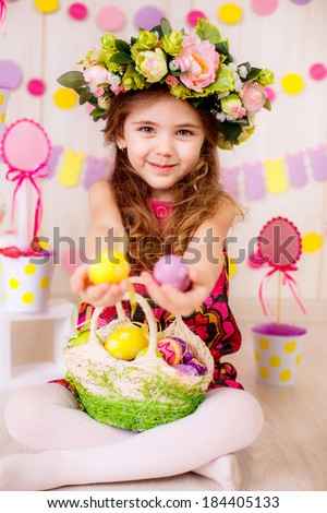 Easter concept.   girl in the room with Easter decorations.   Easter eggs.