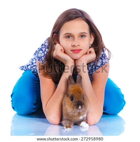 Easter concept image. Cute girl with adorable rabbit over isolated white background. - stock photo