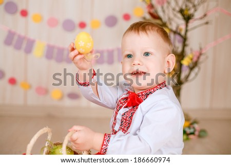 Easter concept. Ukrainian boy suit with Easter eggs.  holidays, spring