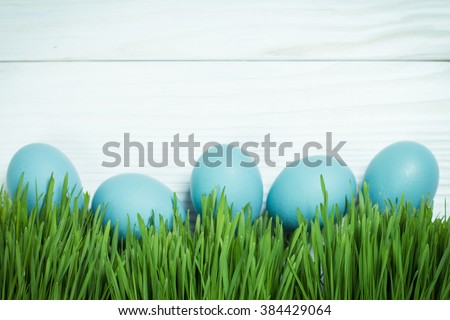 Easter concept with colorful eggs on wooden background - stock photo