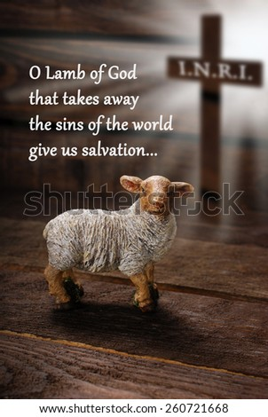 easter concept with cross in light rays and lamb as a symbol of  sacrifice offered to God with text in english - stock photo