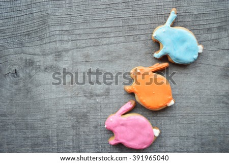 Easter cookies.Easter homemade gingerbread cookie over wooden table.Easter eggs cookies decorated - stock photo
