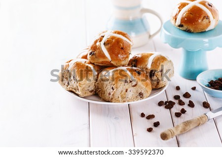 Easter cross-buns on white wooden background with copy space. Selective focus, shallow depth of field - stock photo