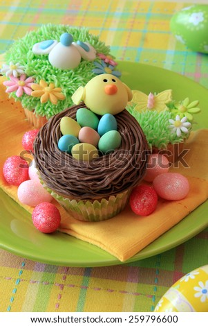 Easter cupcake with Easter eggs and a chick made of fondant.  - stock photo