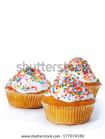 Easter cupcakes sprinkled on a white background - stock photo