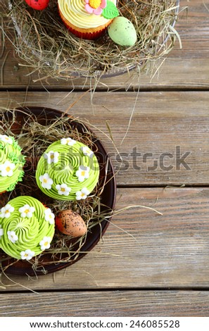 Easter cupcakes top view on boards - stock photo