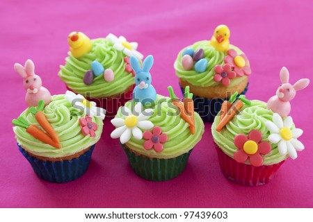 Easter cupcakes with bunnies, chicks, eggs, flowers and carrots made from icing sugar - stock photo