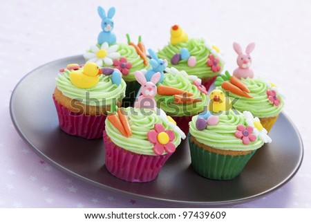 Easter cupcakes with bunny, eggs, flowers and carrots made from icing sugar