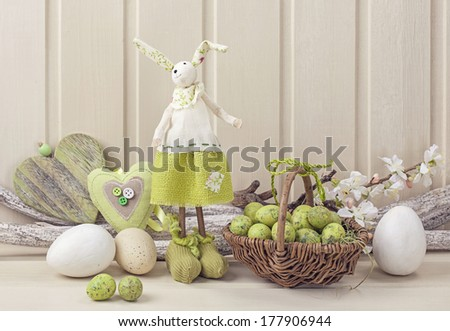 Easter decoration on a white wooden background - stock photo