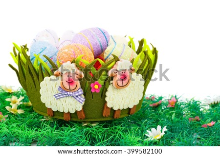 Easter decoration with colorful eggs in basket on artificial grass. - stock photo