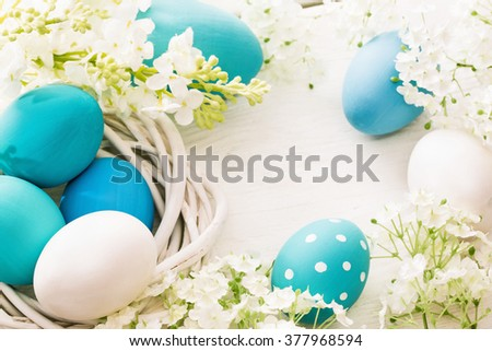 Easter decoration with eggs and flowers - stock photo