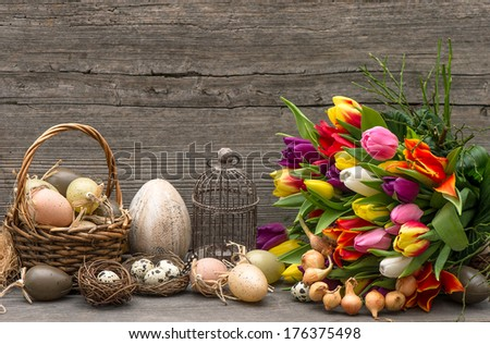 easter decoration with eggs and tulip flowers. nostalgic still life. vintage style home interior - stock photo