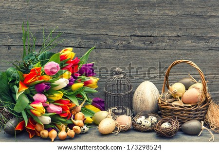 easter decoration with eggs and tulip flowers. nostalgic still life. vintage style toned picture - stock photo