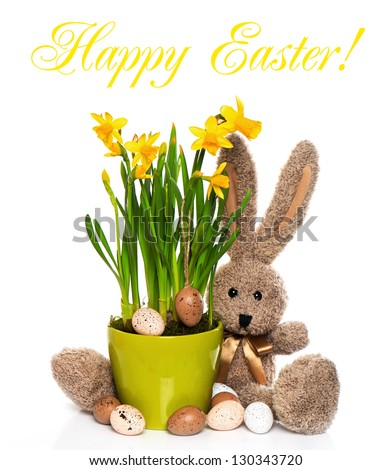 easter decoration with eggs, narcissus flowers and bunny on white background. sample text Happy Easter! - stock photo