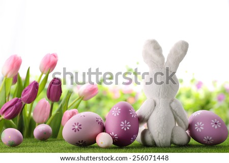 Easter decoration with rabbit,eggs and flowers. - stock photo