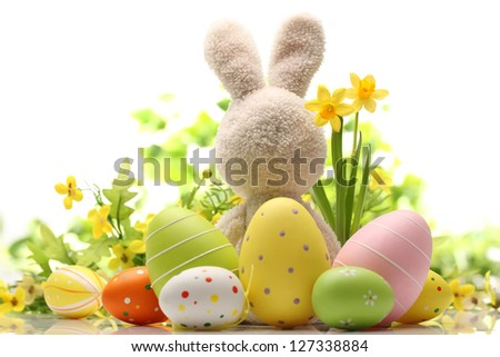 Easter decoration with sugar rabbit,eggs and flowers. - stock photo