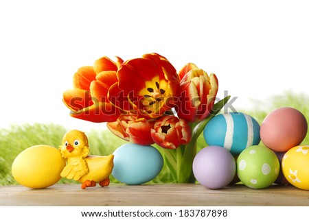 Easter decoration with tulips and colored eggs - stock photo