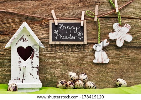 easter decoration, wood background, blackboard, Happy Easter - stock photo