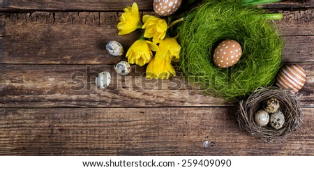 Easter decorations on a dark textured surface with copyspace - stock photo