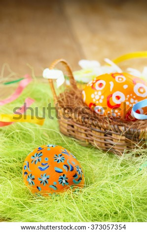 Easter decorations - painted eggs in the basket - stock photo