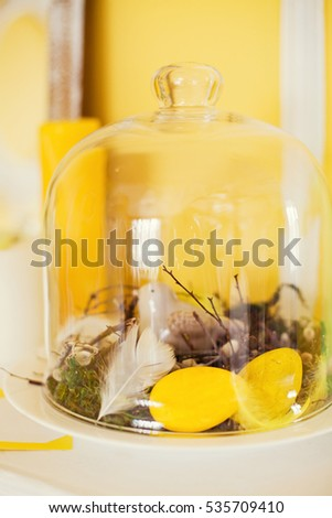 Easter decorations under glass cover
