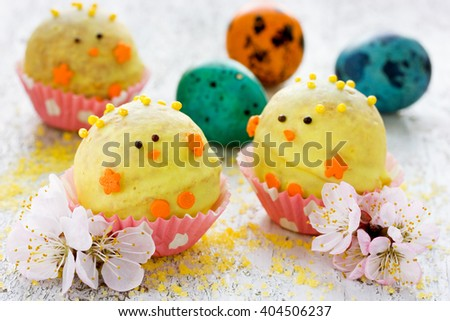 Easter dessert cake in shape of yellow chick in chocolate. Festive treat for children selective focus