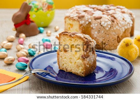 Easter dove-shaped traditional Italian sliced in a dish - stock photo