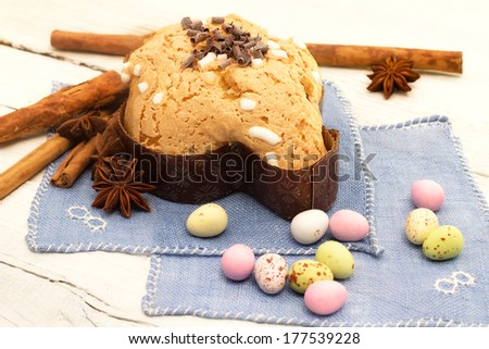 easter dove with chocolates over white wood