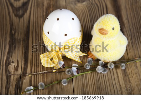Easter duck with catkins, eggs