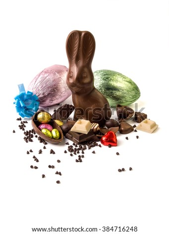 Easter egg and chocolate rabbit on white background - stock photo