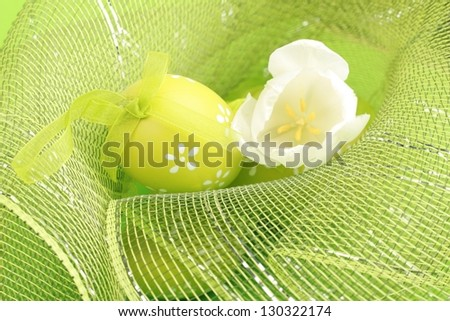 Easter egg and white tulip - stock photo