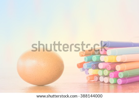 Easter Egg Chickens and color pen on wooden table - stock photo