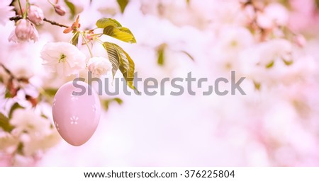 Easter egg decorated on blooming cherry tree,Closeup. - stock photo