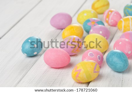 Easter Egg Group of Various Spring Colors on White or Gray Board with space or room for copy, text, words.   Focus on front egg.  Closeup horizontal  - stock photo