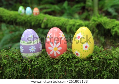 Easter egg in a mossy forest. - stock photo