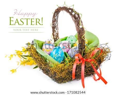 easter egg in basket with spring flower isolated on white background - stock photo