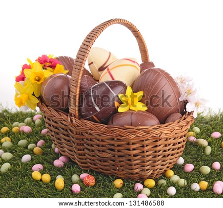 easter egg in wicker basket with flower - stock photo