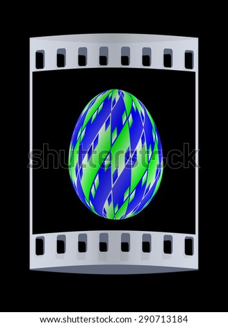 Easter egg on a black background. The film strip with place for your text - stock photo