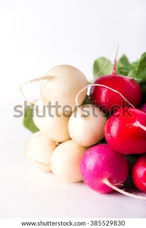 Easter egg radishes on a white board - stock photo