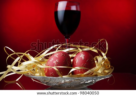 easter egg,red wine, colored background