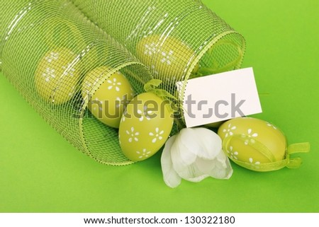 Easter egg with decorative ornaments  and white tulip - stock photo