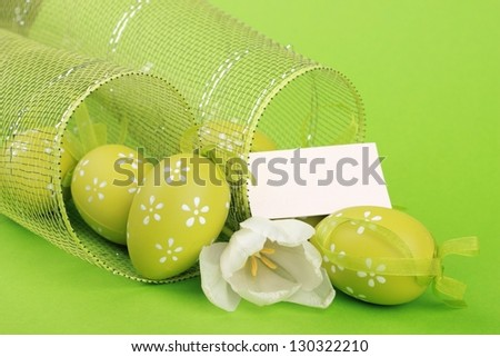 Easter egg with decorative ornaments  and white tulip with card for your text - stock photo