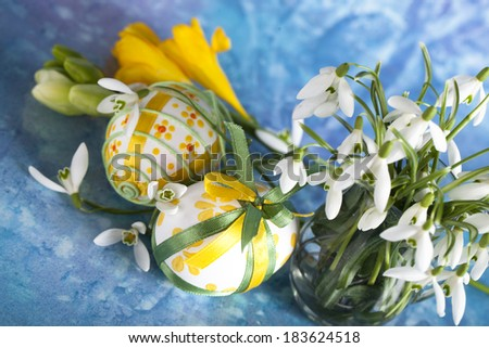 Easter eggs and flower - stock photo