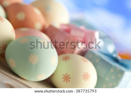 Easter eggs gift boxes pastel colors stock photo royalty free easter eggs and gift boxes in pastel colors on blue sky background negle Image collections