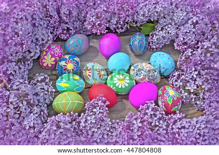 Easter eggs and  lilac  on a old wooden background - stock photo