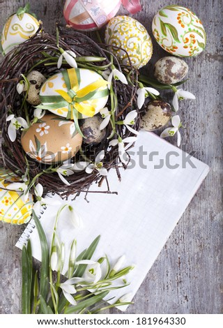 Easter eggs and paper - stock photo