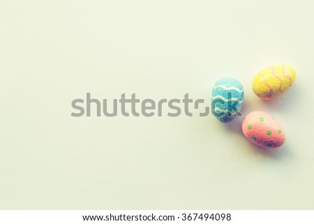 Easter Eggs and Pastel Background - stock photo