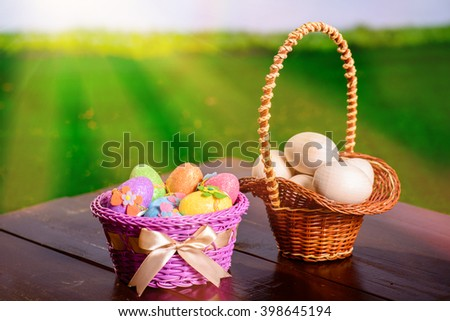 Easter eggs and preparations for eggs  on a wooden table and a basket.